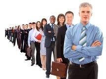 Bedrijfs mens en zijn team Royalty-vrije Stock Foto's