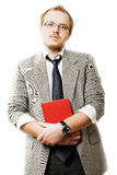 Bedrijfs mens in kostuum met rood boek Royalty-vrije Stock Foto's