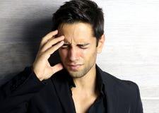 bedrijfs mens met een hoofdpijn Stock Foto