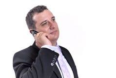 Bedrijfs mens met een mobiele telefoon Stock Afbeeldingen