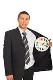 Bedrijfs mens met klok in binnenland van jasje Royalty-vrije Stock Foto's