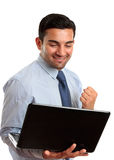 Bedrijfs mens met laptop computersucces, overwinning Royalty-vrije Stock Foto's