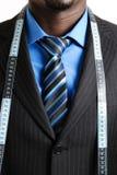 Bedrijfs mens met meetlint royalty-vrije stock afbeeldingen