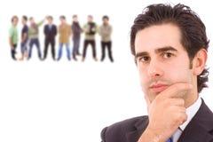 Bedrijfs mens met sommige mensen arround Stock Foto's