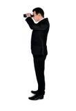 Bedrijfs mens met verrekijkers Stock Foto