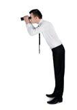 Bedrijfs mens met verrekijkers Stock Afbeeldingen