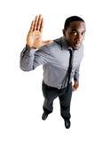 Bedrijfs mens met zijn omhoog hand royalty-vrije stock foto