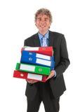 Bedrijfs mens met zwaar archief stock afbeelding