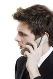Bedrijfs mens op celtelefoon over wit royalty-vrije stock fotografie