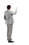 Bedrijfs mens van de rug die - iets bekijkt Stock Fotografie