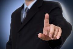 Bedrijfs mens wat betreft het denkbeeldige scherm royalty-vrije stock afbeeldingen