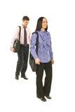 Bedrijfs mensen die aan hun banen lopen Stock Foto