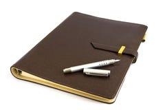 Bedrijfs organisator met zilveren pen Stock Foto