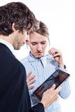 Bedrijfs paar met tabletcomputer stock foto