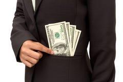 Bedrijfs vrouw die dollar zet. Royalty-vrije Stock Foto's