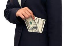Bedrijfs vrouw die dollar zet. Royalty-vrije Stock Fotografie