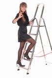 Bedrijfs vrouw die ladder beklimt Stock Afbeelding
