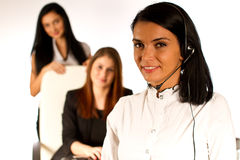 Bedrijfs vrouw die met hoofdtelefoon 2 werken Royalty-vrije Stock Afbeeldingen