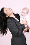 Bedrijfs vrouw en baby stock afbeelding