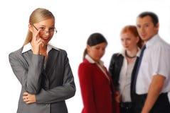 Bedrijfs vrouw en haar team Stock Afbeelding