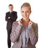 Bedrijfs vrouw in kostuum met geïsoleerdee de mens Stock Fotografie