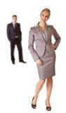 Bedrijfs vrouw in kostuum met geïsoleerdee de mens Royalty-vrije Stock Afbeelding