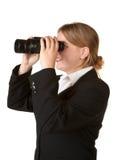 Bedrijfs vrouw met verrekijkers Stock Foto's