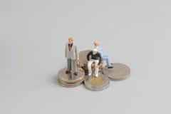 Bedrijfscijfer aangaande de bovenkant van muntstukkenstapel Royalty-vrije Stock Afbeeldingen