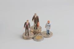 Bedrijfscijfer aangaande de bovenkant van muntstukkenstapel Stock Afbeelding
