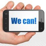 Bedrijfsconcept: Handholding Smartphone met kunnen wij! op vertoning Stock Fotografie
