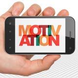 Bedrijfsconcept: Handholding Smartphone met Motivatie op vertoning Stock Afbeelding