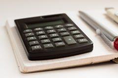 Bedrijfsconcept met calculator, notitieboekje Stock Foto