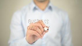 Bedrijfscontinuïteit, mens die op het transparante scherm schrijven Stock Afbeelding