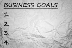 Bedrijfsdoelstellingen met verfrommelde document achtergrond Stock Fotografie