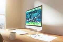 Bedrijfsgrafiek op het computerscherm met kop van koffie op houten t Stock Foto