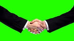 Bedrijfshanddruk op groene het schermachtergrond, vennootschapvertrouwen, eerbiedteken royalty-vrije stock afbeeldingen