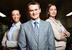 Bedrijfsleider en werknemers royalty-vrije stock fotografie