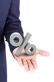 Bedrijfsmens die een 3d in hand palm van het percentensymbool houden Royalty-vrije Stock Afbeelding