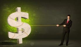 Bedrijfsmens die een groot groen dollarteken trekken royalty-vrije stock afbeelding