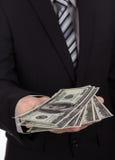 Bedrijfsmens die een Verspreiding tonen royalty-vrije stock foto