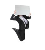 Bedrijfsmens die en aanplakbord springen houden Stock Afbeelding