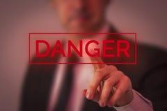 Bedrijfsmens die gevaar kiezen Royalty-vrije Stock Afbeeldingen