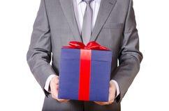 Bedrijfsmens die huidige doos houden Stock Foto's