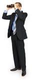 Bedrijfsmens die kostuum met blauwe band met verrekijkers dragen Royalty-vrije Stock Foto