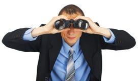 Bedrijfsmens die kostuum met blauwe band met verrekijkers dragen Stock Foto