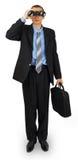 Bedrijfsmens die kostuum met zak en verrekijkers dragen Royalty-vrije Stock Fotografie