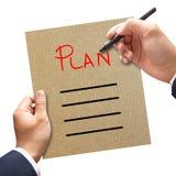 Bedrijfsmens die lege planlijst schrijven Stock Foto's