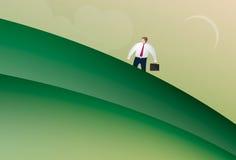 Bedrijfsmens die omhoog een heuvel lopen Stock Foto's