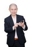 Bedrijfsmens die slimme telefoon met behulp van Stock Foto
