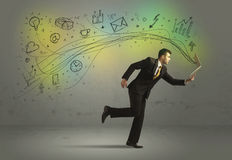 Bedrijfsmens in een stormloop met krabbelmedia pictogrammen Stock Foto's